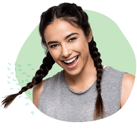 woman with brown hair in boxer braids smiling