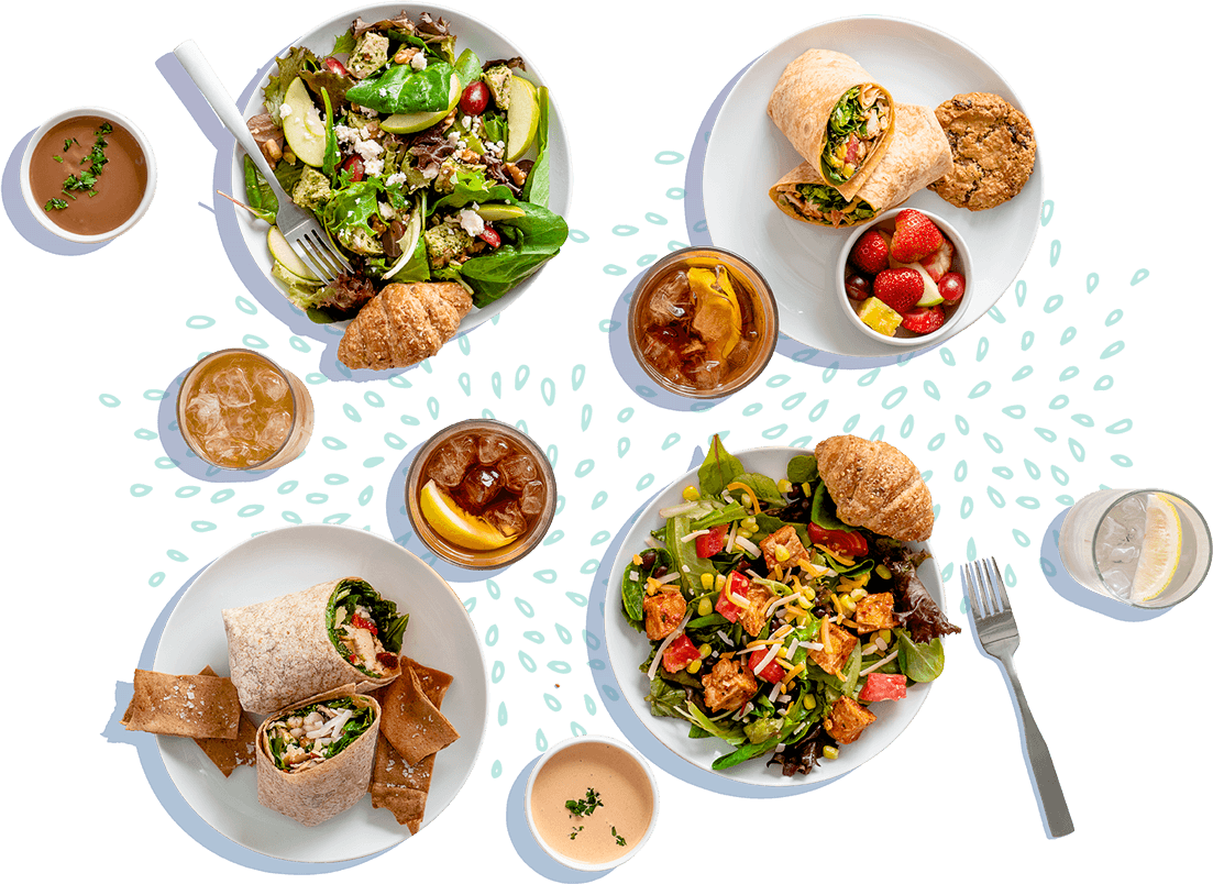 A composition of salads and wraps on plates with iced tea