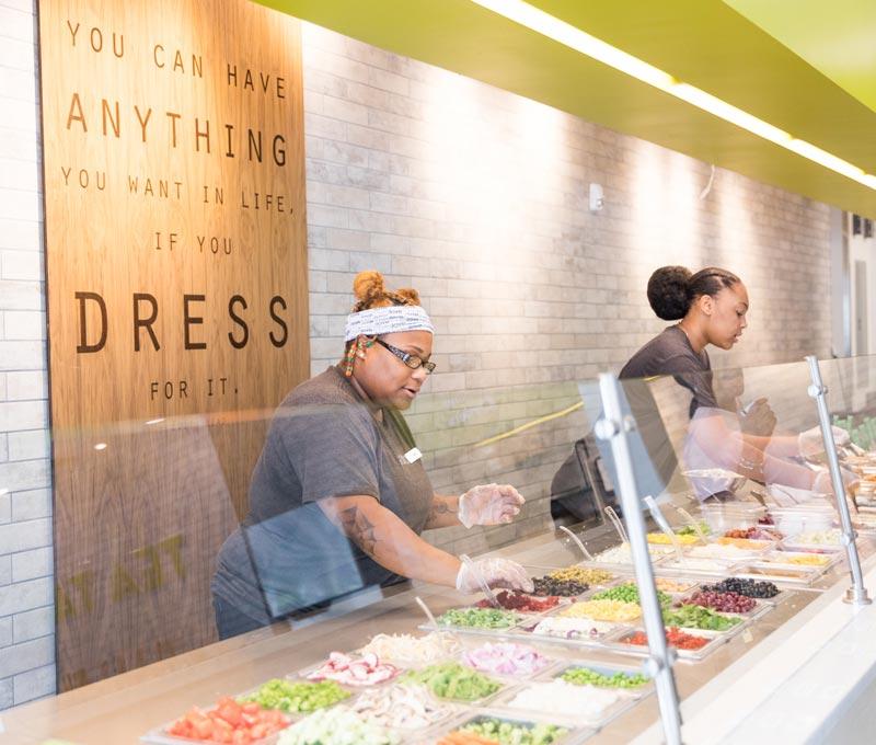 Salata employees building salads